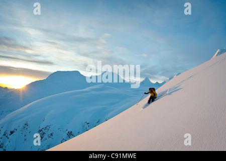 Skier skiing powder snow above Thompson Pass on Girls Mountain near Valdez, Chugach Mountains, Winter in Southcentral - Stock Photo
