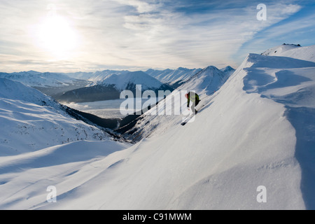 Skier skiing in Peterson Creek in the Western Chugach, above Turnagain Arm near Girdwood, Winter in Southcentral - Stock Photo