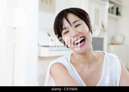 Close up of woman laughing - Stock Photo