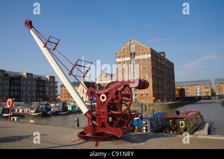 Gloucester England October  Crane on quayside and Narrowboats  moored regenerated Victoria Docks area, - Stock Photo