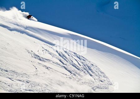 Man backcountry skiing in powder snow at Wolverine Bowl, Turnagain Pass,  Kenai Mountains, Southcentral Alaska, - Stock Photo