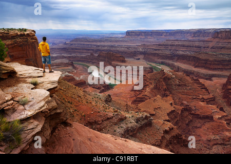 Tourist at Dead Horse Point watching the Colorado River, Dead Horse Point State Park - Stock Photo