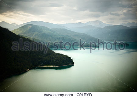 Aerial view of mountains and still lake - Stock Photo