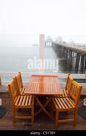 Tables, restaurant, Malibu Pier, Los Angeles, California, United States of America - Stock Photo