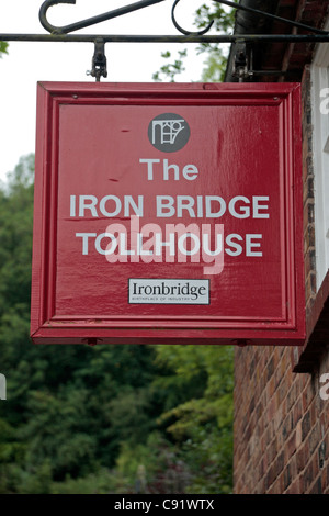Sign on the tollhouse of the historic Iron Bridge, the first of its kind built in 1779, in Ironbridge Gorge, Shropshire, - Stock Photo
