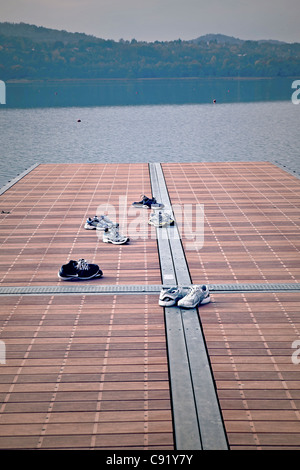 multiple sneakers on a pier - Stock Photo
