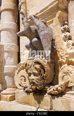 Ornate sandstone fountain,  located in St George's Square, Misrah San George or Palace Square, in Valletta. - Stock Photo
