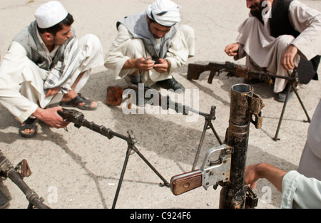 Former militia fighters gather at an army base, as part of a UN DDR program in Kabul, Afghanistan - Stock Photo