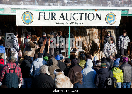 Crowds at the fur auction during 2011 Fur Rondy festival in downtown Anchorage, Southcentral Alaska, Winter - Stock Photo