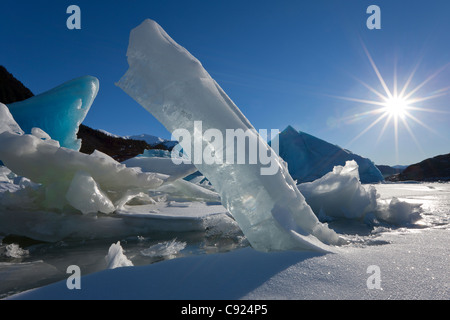 Scenic of large icebergs frozen in Mendenhall Lake on a sub zero sunny day, Inside Passage, Southeast Alaska, Winter - Stock Photo