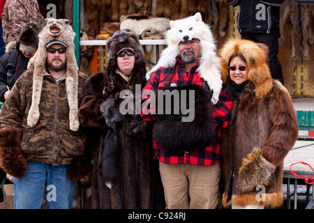 Four spectators dressed in fur coats and hats during the Fur Auction in Anchorage, 2011 Fur Rondy festival, Southcentral - Stock Photo