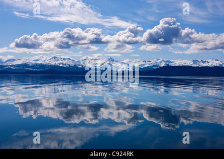Scenic view of the Chilkat Mountains reflecting in Lynn Canal, Inside Passage, Juneau, Southeast Alaska, Spring - Stock Photo