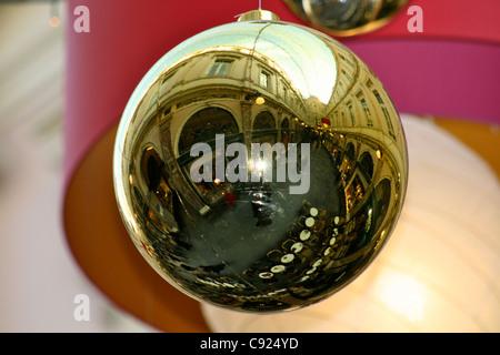 Christmas decorations of reflective golden balls in Galerie de la Reine Queens gallery in the Galeries Royales Saint - Stock Photo