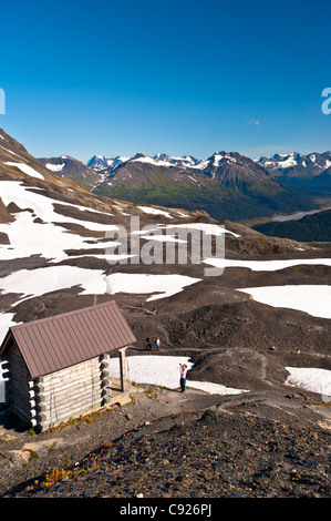 Scenic view of hikers at the Harding Icefield Shelter overlooking Exit Glacier, Kenai Fjords National Park, Alaska - Stock Photo