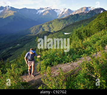 Woman hikes the steep North Face Trail at Alyeska Resort in Girdwood, Southcentral Alaska, Summer - Stock Photo