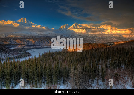 Scenic view of the Chugach Mountian Range at sunset as seen from the Glenn Highway, Southcentral Alaska, Winter. - Stock Photo