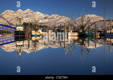 Valdez Harbor with boats and mountains reflected in the water in the evening, Southcentral Alaska, Winter. HDR - Stock Photo