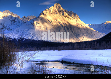 Winter sunset on the Chugach Mountains just outside of Valdez with Lowe River in the foreground, Southcentral Alaska, - Stock Photo