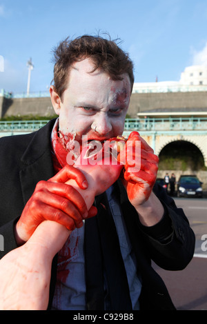 The quirky annual Zombie Walk held on an Autumn weekend, from the railway station to the beach in Brighton, East - Stock Photo