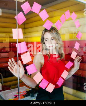 Businesswomen making heart with notes - Stock Photo