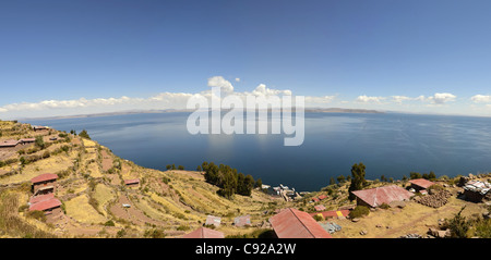 housing poor view lake titicaca house roof sky poverty basic blue cloud highest navigable taquile island puno horizon - Stock Photo