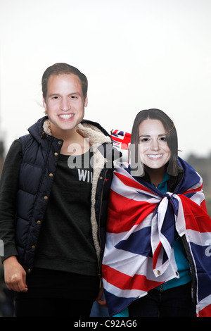 'Prince William and Kate Middleton' masked lookalikes in the London Eye, during the start of the Royal Wedding London, - Stock Photo