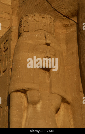 Egyptian Art. Temple of Ramses II. Nefertari. Statue near the feet of the colossi of Ramses II. Abu Simbel. Egypt. - Stock Photo