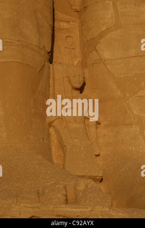 Egyptian Art. Temple of Ramses II. Young prince. Statue near the feet of the colossi of Ramses II. Abu Simbel. Egypt. - Stock Photo