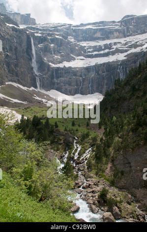 View towards the Cirque de Gavarnie and the Gavarnie river. Parque National des Pyrenees. - Stock Photo