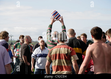 The annual Bottle Kicking and Hare Pie Scramble, held on Easter Monday in Hallaton, Leicestershire, England. - Stock Photo