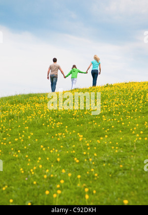 Family walking and holding hands - Stock Photo