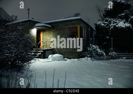 Snow covered house and front yard - Stock Photo