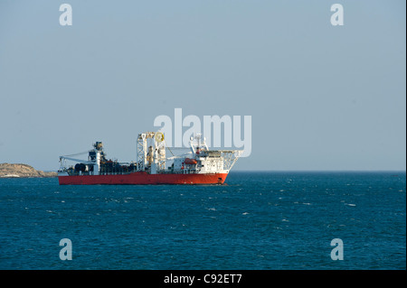 Off-shore diamond mining ship anchored in the bay of Luederitz in Namobia - Stock Photo