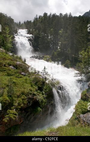 The Cascade de Lutour turns into a foaming torrent after heavy rains and pours down the hillside near the village - Stock Photo