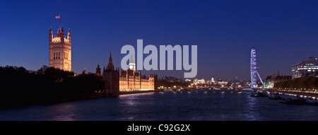 Panoramic view over the river Thames at night, London, England - Stock Photo
