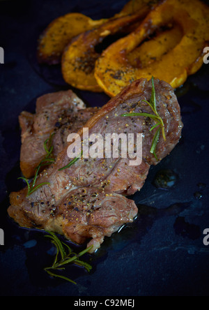 Cooked  grilled leg of lamb steak - Stock Photo