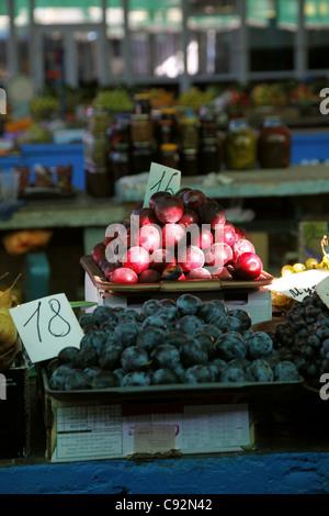 RED & BLACK PLUMS ON FRUIT STALL SEVASTOPOL CRIMEA UKRAINE 28 September 2011 - Stock Photo