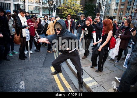 Anarchists dancing during student march through central London to protest against rises in tuition fees and changes - Stock Photo