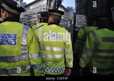 London, UK, 09/11/2011 Police containing the crowd are reflected in a plate glass window during a national demonstration - Stock Photo