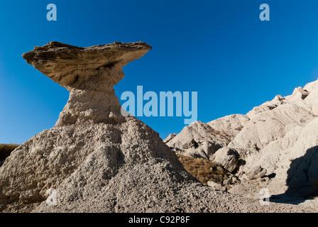 Balancing rock, Badlands National Park, South Dakota. - Stock Photo