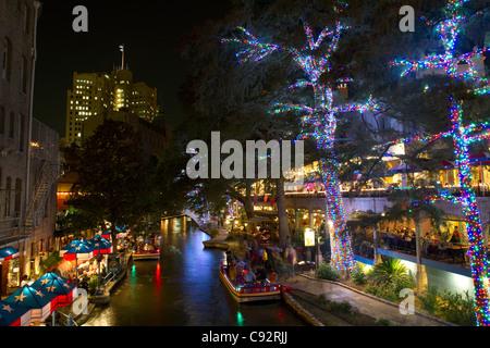 San Antonio River Walk Texas USA Night Scene Boat Lights Crowds - Stock Photo