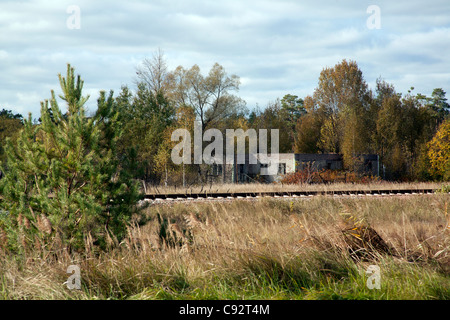 Abandoned checkpoint and railway line through the 10 km exclusion zone Chernobyl Ukraine - Stock Photo