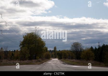 Empty road through the 10 km exclusion zone Chernobyl Ukraine - Stock Photo