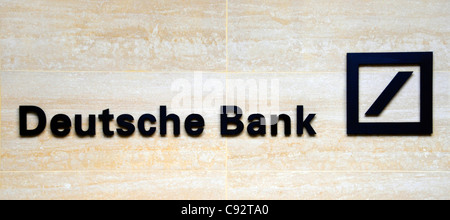 Deutsche Bank sign & logo on office building wall in the financial district square mile of the City of London England - Stock Photo