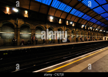 The platform at Notting Hill Gate tube station in London in the early morning. - Stock Photo