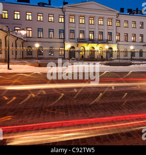 Traffic by Presidential Palace in Helsinki - Stock Photo