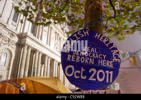 Spoof English Heritage blue plaque Occupy London protest camp St Paul's Cathedral London England UK - Stock Photo