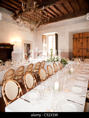 It is traditional after weddings for the guests to enjoy an often formal meal together. Here at Villa Catureglio - Stock Photo