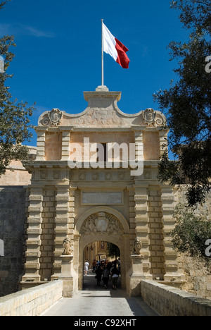 The medieval gate to the old city in Mdina on Malta is an impressive entry into the historic town. - Stock Photo