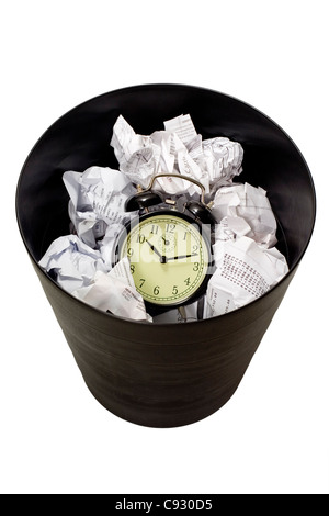 Clock in waste paper basket isolated on white background - Stock Photo